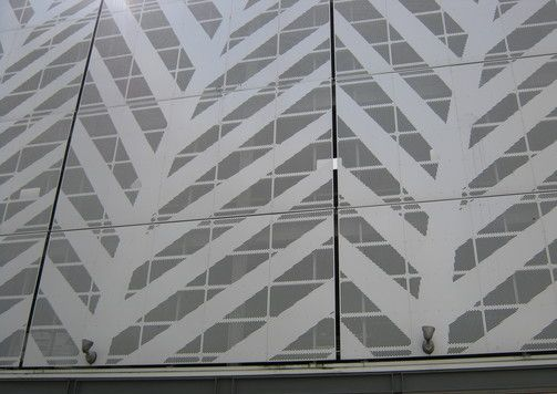 Installed aluminium perforated cladding panels, fern pattern.